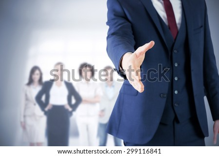 Composite image of businessman ready to shake hand - stock photo