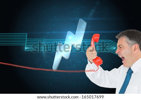 Composite image of businessman screaming directly into the red telephone handset - stock photo