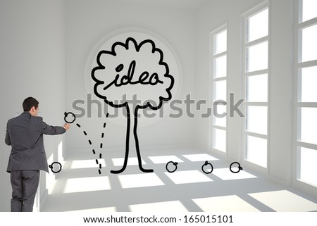 Composite image of businessman standing on ladder writing - stock photo