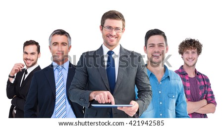 Composite image of businessman using his tablet pc - stock photo