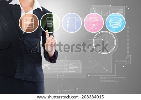 Composite image of businesswoman pointing at menu against grey vignette - stock photo