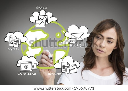 Composite image of businesswoman writing doodle against grey vignette - stock photo
