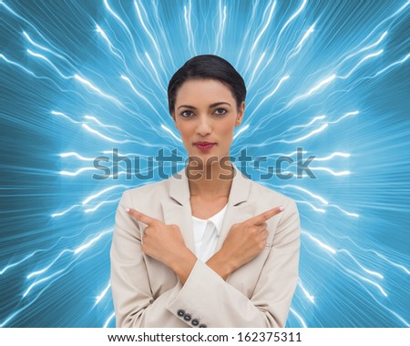 Composite image of charismatic businesswoman with her arms crossed and fingers pointing  - stock photo