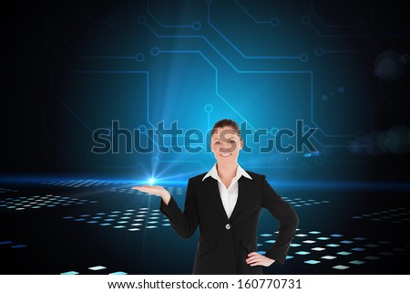 Composite image of charming woman in suit showing a copy space while standing against a white background