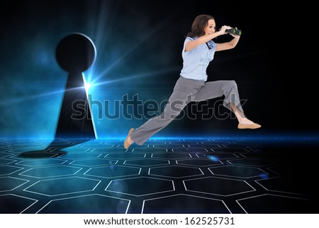 Composite image of cheerful classy businesswoman  jumping while holding binoculars - stock photo
