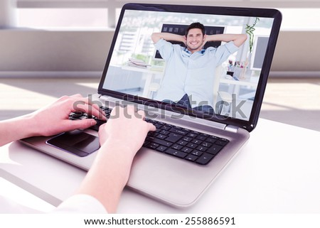 Composite image of cheerful creative business employee resting - stock photo