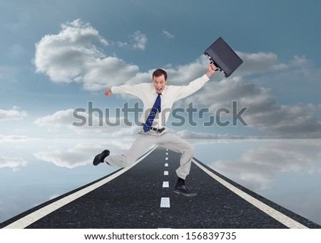 Composite image of cheerful jumping businessman with his suitcase over the street - stock photo