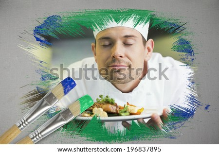 Composite image of chef smelling his dish with paintbrush dipped in green against digitally generated grey background - stock photo