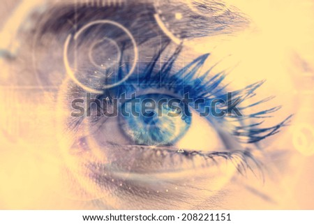 Composite image of close up of female blue eye against interface - stock photo