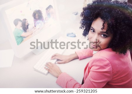Composite image of creative team going over contact sheets in meeting - stock photo