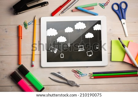 Composite image of digital tablet on students desk showing cloud computing doodle - stock photo