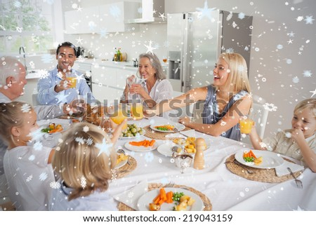 Composite image of Family raising their glasses together against snow - stock photo