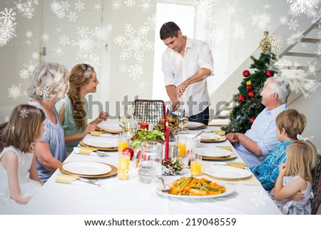Composite image of Father serving Christmas meal to family against snowflakes - stock photo