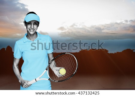 Composite image of female athlete posing with her tennis racket and ball against blurred mountains