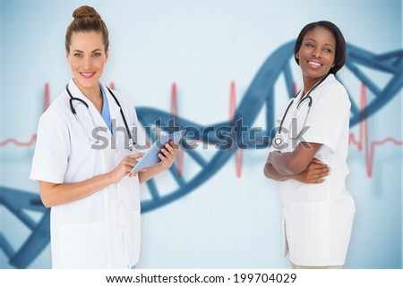 Composite image of female medical team against blue medical background with dna and ecg - stock photo