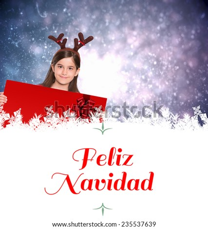 Composite image of festive little girl showing card against Christmas greeting - stock photo
