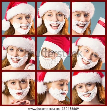 Composite image of festive redhead in foam beard - stock photo