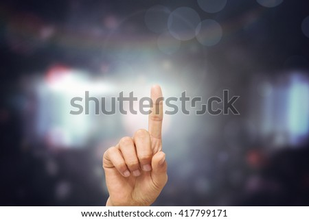Composite image of finger pointing on a blurred background - stock photo