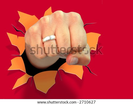Composite image of fist punching a red paper wall, producing a hole. - stock photo
