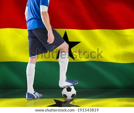 Composite image of football player standing with ball against digitally generated ghana national flag - stock photo