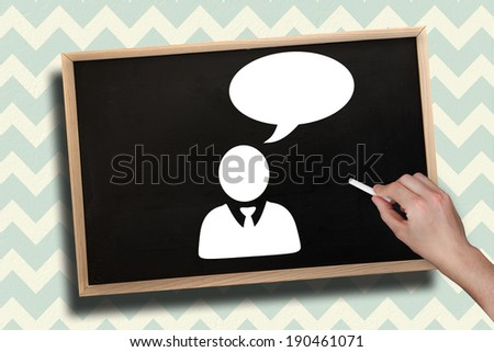 Composite image of hand drawing businessman with chalk on chalkboard with wooden frame - stock photo