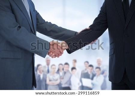 Composite image of handshake in agreement - stock photo