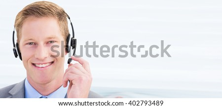 Composite image of handsome agent wearing headset - stock photo