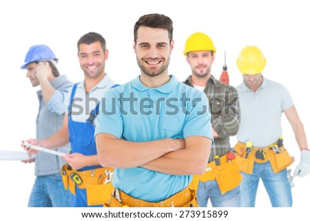Composite image of happy carpenter standing arms crossed - stock photo