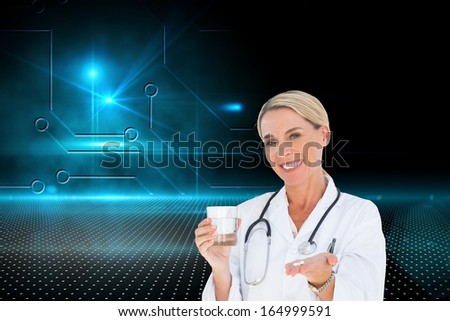 Composite image of happy doctor holding out pills and water glass - stock photo