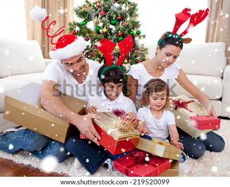 Composite image of Happy family opening Christmas presents at home with snow falling - stock photo