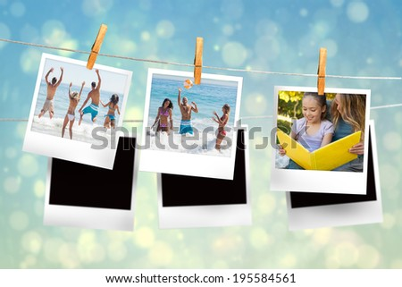 Composite image of instant photos hanging on a line against blue bubble design - stock photo
