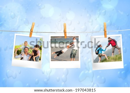 Composite image of instant photos hanging on a line against blue water drop background