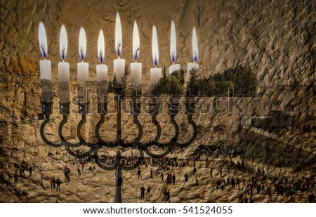 Composite image of menorah with glittering candles and western wall in Jerusalem. The image symbolizes Hanukkah Holiday and Jewish desires and hopes. Toned for inspiration of retro style