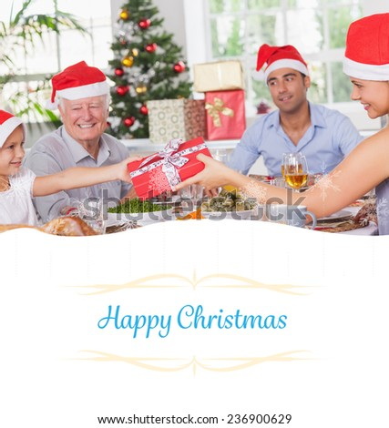 Composite image of mother giving daughter christmas present against border - stock photo