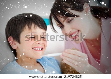 Composite image of positive nurse and his patient looking at a thermometer against snow - stock photo
