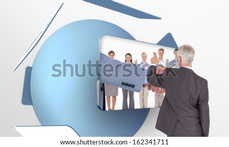 Composite image of rear view of classy mature businessman pointing finger