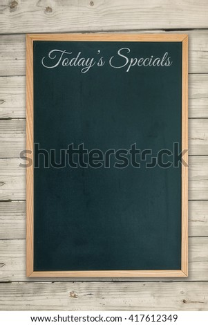Composite image of restaurant board menu on a wooden desk