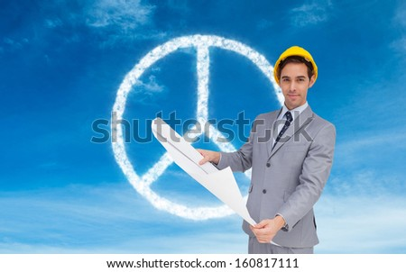Composite image of serious architect with hard hat holding plans - stock photo