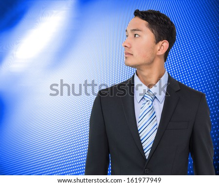 Composite image of serious asian businessman  - stock photo