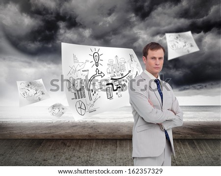 Composite image of serious businessman standing with his arms folded - stock photo
