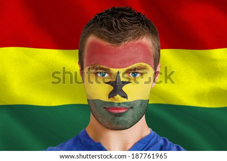 Composite image of serious young ghana fan with facepaint against digitally generated ghana national flag - stock photo