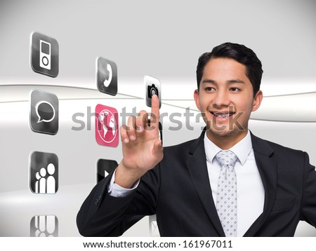 Composite image of smiling asian businessman pointing - stock photo