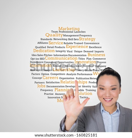 Composite image of smiling asian businesswoman pointing - stock photo