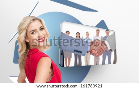Composite image of smiling attractive blonde standing hands on hips - stock photo