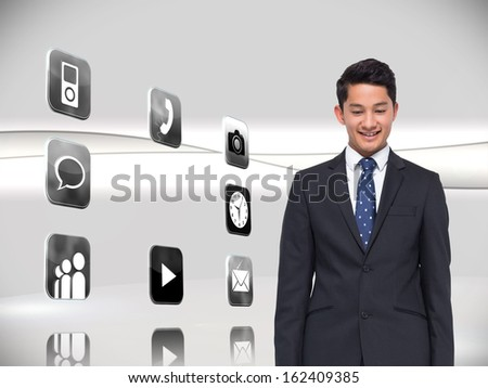 Composite image of smiling businessman looking down - stock photo