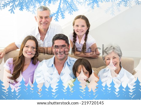 Composite image of smiling multigeneration family against frost and fir trees - stock photo
