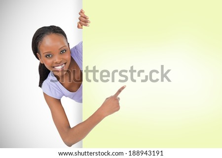 Composite image of smiling young girl showing yellow card - stock photo