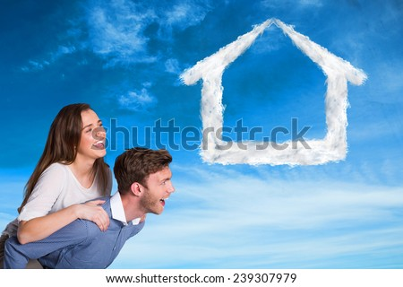 Composite image of smiling young man carrying woman against blue sky - stock photo