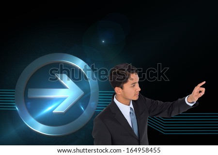 Composite image of stern asian businessman pointing