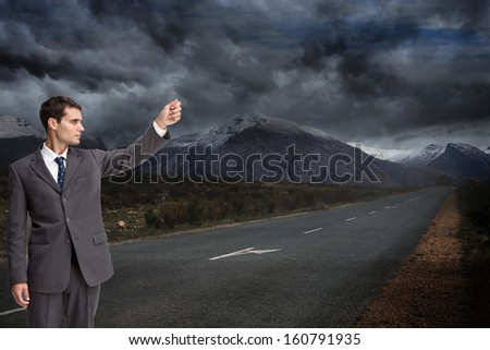 Composite image of stern attractive businessman pointing